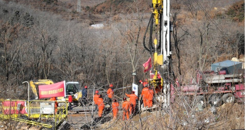 Delayed but not defeated, Chinese rescuers fight the odds to rescue miners