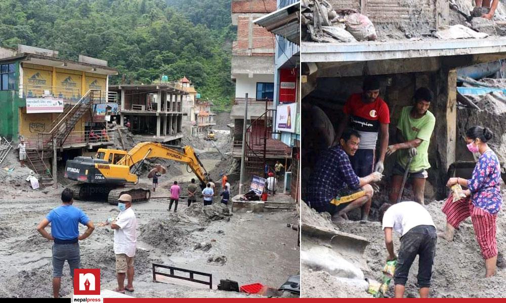Residents of Melamchi evacuating mud piled up at home using Bulldozer (Images)