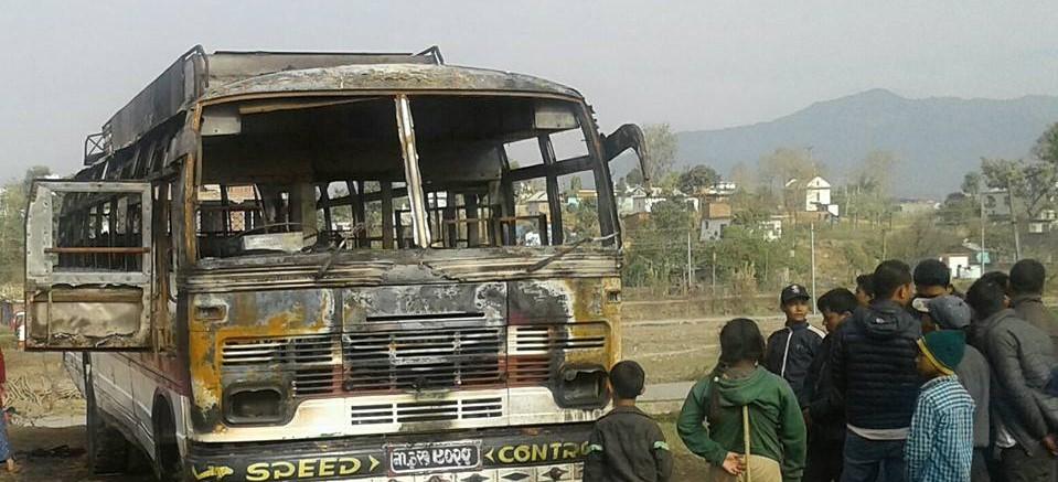 Moving bus catches fire in Gajuri